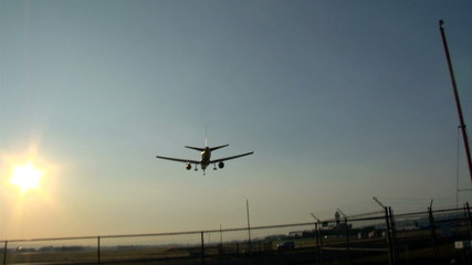 Airplane Landing Sunset