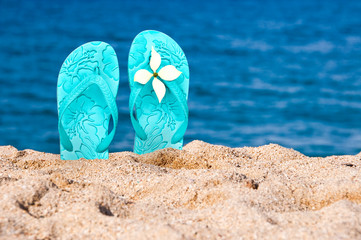 Pair of flip flops in the sand of a beach