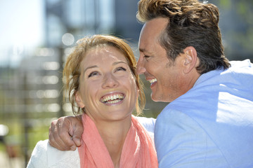 Portrait of mature loving couple enjoying sunny day