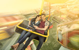 Happiness couple riding on ferris wheel