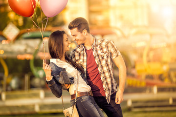 Affectionate couple having fun in amusement park