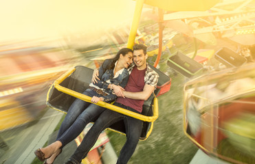 Happiness couple riding on ferris wheel