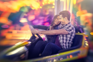 Happy couple ride bumper car