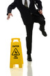Businessman Slipping on Wet Floor