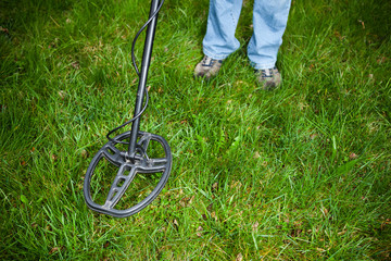 searching for a precious metal with a metal detector