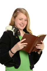 Girl Reading Bible with Pet Rat on Shoulder