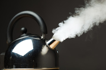 boiling kettle with dense steam