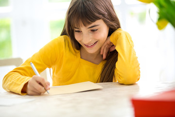 Cute girl writing a letter