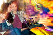 Young couple in love in a bumper car / dodgem ride