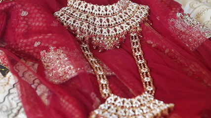 indian jewelry lays on indian cloths