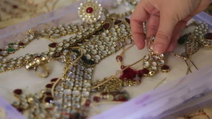 iindian hand show jewelry in box