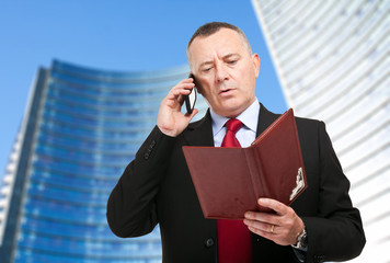 Businessman talking on the phone in an urban setting