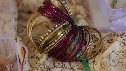 indian ring bracelet on textile near box