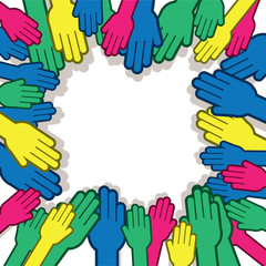 Many hands reaching towards one another in various colors