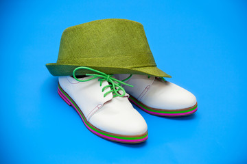 white shoes and green hat on a blue background