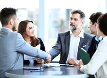 """Постер, картина, фотообои """"Business people shaking hands, finishing up a meeting """""""