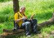 Short relaxation of mature outdoor photographer