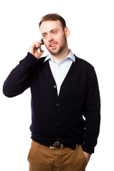Relaxed man talking on a mobile phone