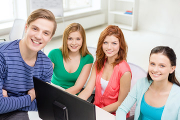 group of smiling students having discussion