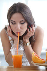 Beautiful girl with orange juice