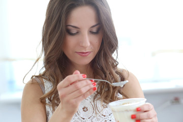 Beautiful girl with yoghurt