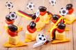 Leinwanddruck Bild - Fußball Pary Snacks in Schwarz Rot Gold für Fans