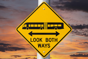 Look Both Ways Bus Warning Sign With Sunset Sky