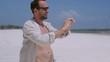 Man taking selfie on the beach