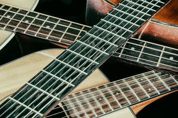 Vintage Acoustic Guitar Necks Crossed