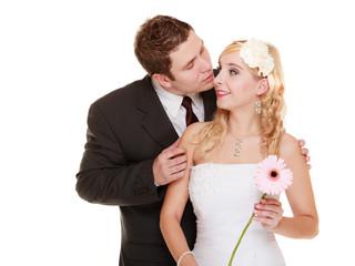Wedding couple. Groom and bride. Man kissing woman