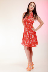 Full length pinup girl woman in retro red dress. Vintage.