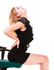 Businesswoman with back pain on chair. Long working hours.