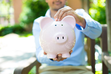Piggy bank savings outside