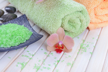 Still life with beautiful blooming orchid flower, towels and