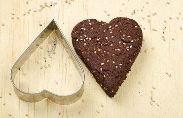 Chocolate chia seed love heart cookie with cookie cutter