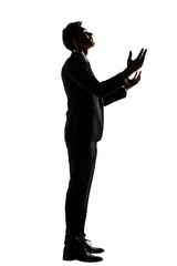 Silhouette of Asian businessman praying