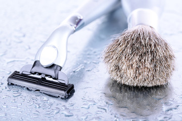 Shaving accessories on gray background