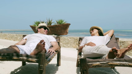 Couple resting on sunbed together