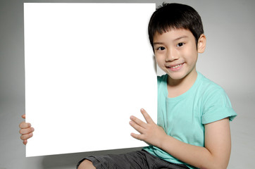 Portrait of Asian child with blank plate for add your text .