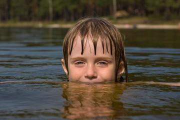 Young beautiful girl in water