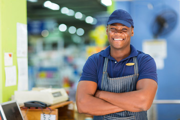 african supermarket cashier standing at checkout