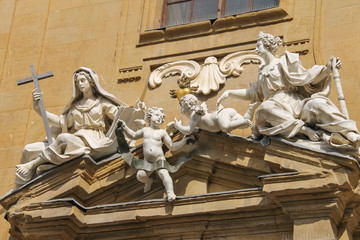 Sculpture composition on building of Court of Justice on Piazza