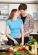 loving couple hugging in the kitchen