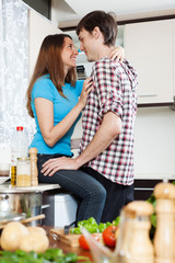couple having sex at domestic kitchen