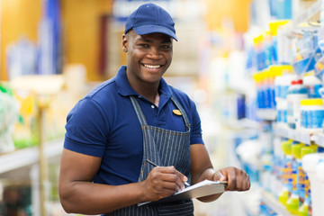 african shop assistant check stock
