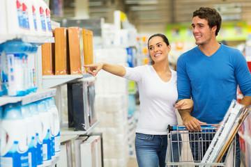 couple shopping at hypermarket