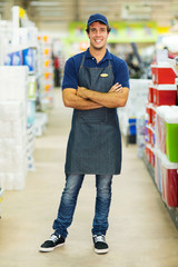 supermarket worker with arms crossed