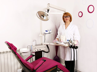 female dentist in dental office