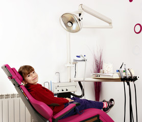 little girl sitting in dentist's chair