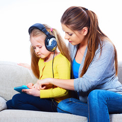 Mother with child learning home work